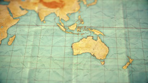 Zoom in from World Map to Australia. Old well used world map with crumpled paper and distressed folds. Vintage sepia colors. Blank version