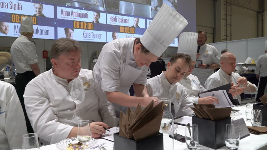 HELSINKI, FINLAND - MARCH 18,2018: The jury trying the dessert. Contest Chef of the Year during the show Gastro Helsinki. Finland's leading trade fair for the hotel, restaurant and catering industry #1008868763
