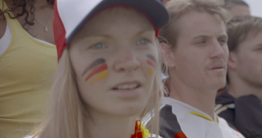 Female sports enthusiast watching match attentively, slow motion | Shutterstock HD Video #1008892403
