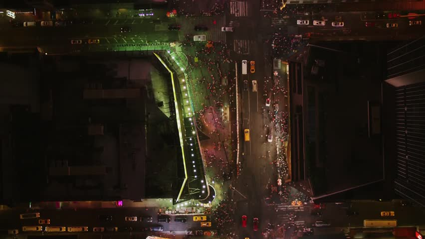 Aerial wide shot of the busiest hours at night in New York downtown | Shutterstock HD Video #1008903383