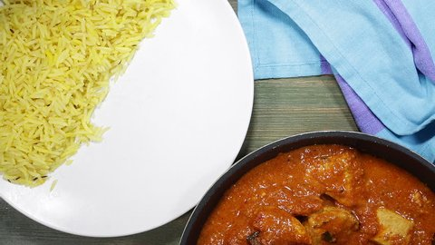 Serving Up An Indian Style Chicken Madras Curry On Pilau Rice