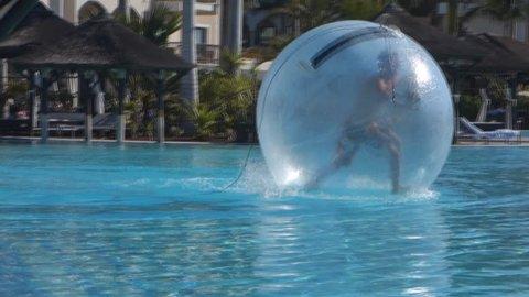 Tenerife, Canary Islands - February 2014. Zorbing, man inside Inflatable Balloon Ball, Tenerife, Canary Islands, Spain