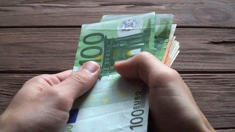 Man Counting Euro Banknotes