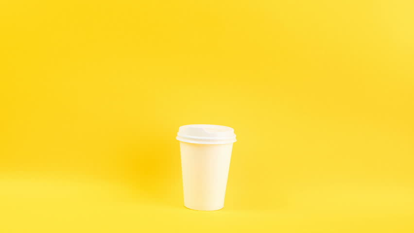 a variety of appearance and color cups for coffee, Bright yellow background. Cool funny video footage timelapse stopmotion.