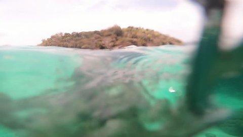 Plastic bag drifts across tropical coral reef. Human impact. Environmental Problem