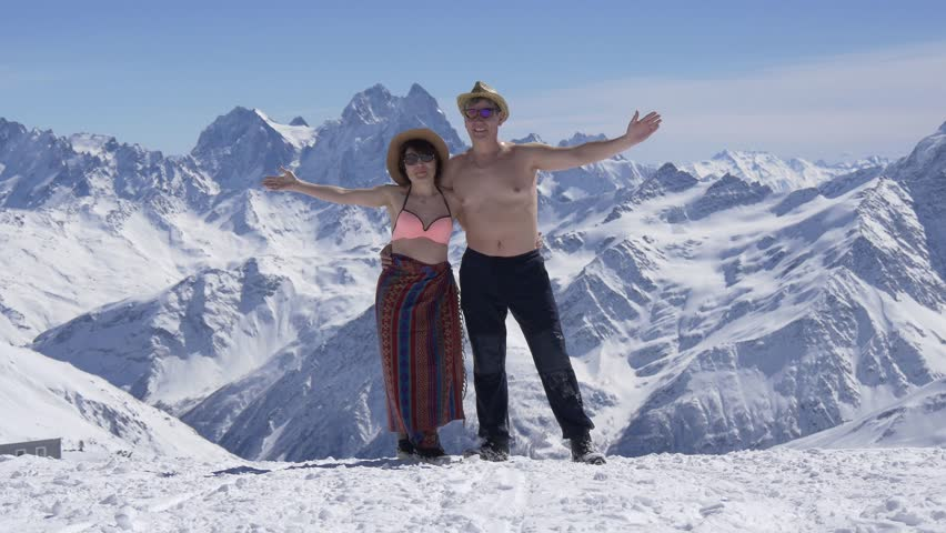 Middle-aged couple man and woman sunbathing in a winter resort
