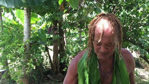 Cook Islander man prepares herbal drink on Eco tourism tour in Rarotonga Cook Islands