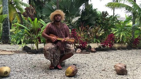 Cook Islander man plays on Ukulele Guitar in Rarotonga, Cook Islands.