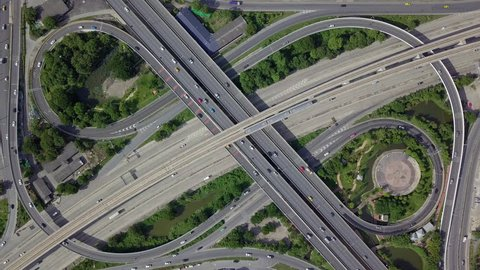 Expressway top view, Top view over the highway, expressway and motorway, Aerial view interchange of a city, Shot from drone, Expressway is an important infrastructure in city.