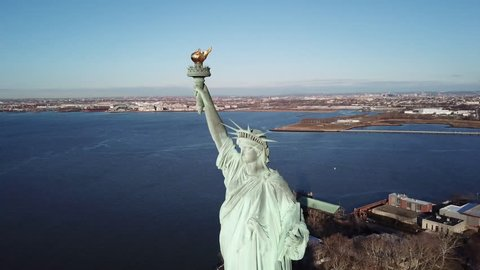 Statue of Liberty aerial circling over vast water in 4K and 1080 HD