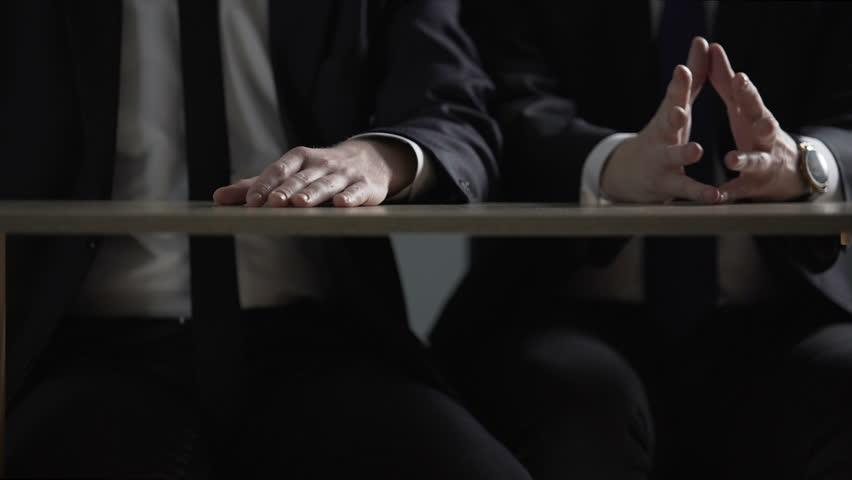 Politician hands taking bribe money under office table, lobbying of interests   Shutterstock HD Video #1009134353