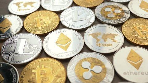 MONTREAL, CANADA - March 2018 : Bitcoin Litecoin Ethereum Ripple coins on a table