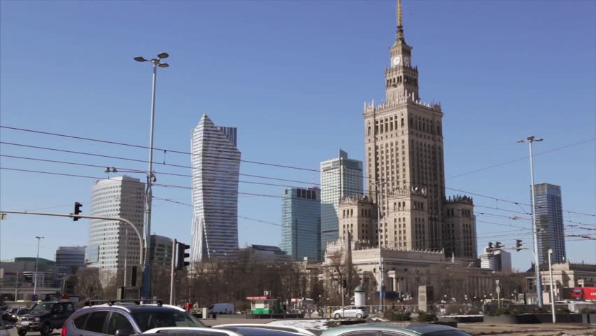 Warsaw-Poland 20. March. 2018.  Busy Warsaw city centre with Palace of Culture and Science and other new skyscrapers in the view, with people walking around. | Shutterstock HD Video #1009155473