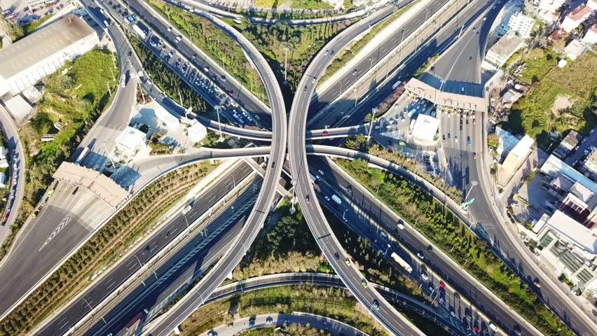 Aerial drone bird's eye view video of popular highway of Attiki Odos multilevel junction road, passing through National motorway, Attica, Greece