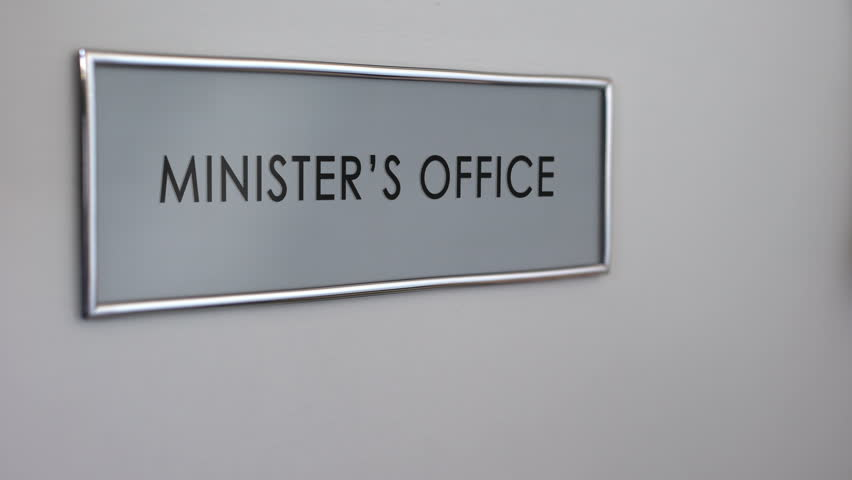 Header of minister