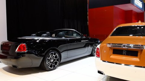 BRUSSELS, BELGIUM - JANUARY 10, 2018: Rolls-Royce Black Badge Dawn convertible and Rolls Royce Phantom (Rolls-Royce Phantom VIII) luxury exclusive cars on display at the 2018 European motor show in Br
