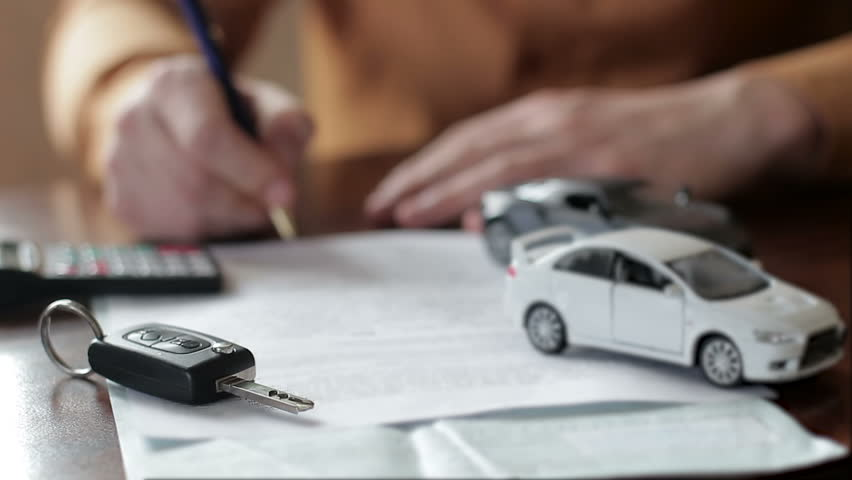 Male hands signing car insurance contract. concept: car insurance, car sales, garages, rental and alarm systems | Shutterstock HD Video #1009211363