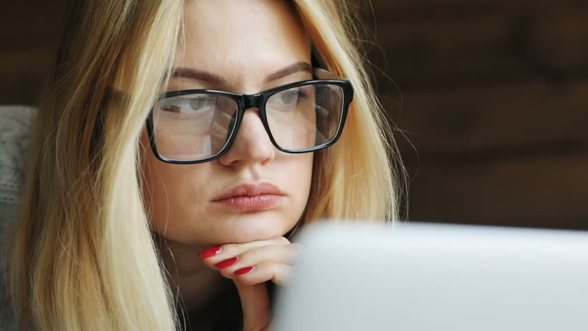 Close-up of young attractive businesswoman finish work and close laptop inside home office female entrepreneur using notebook computer slow motion thoughtful calm face glasses thinking looking away | Shutterstock HD Video #1009219403