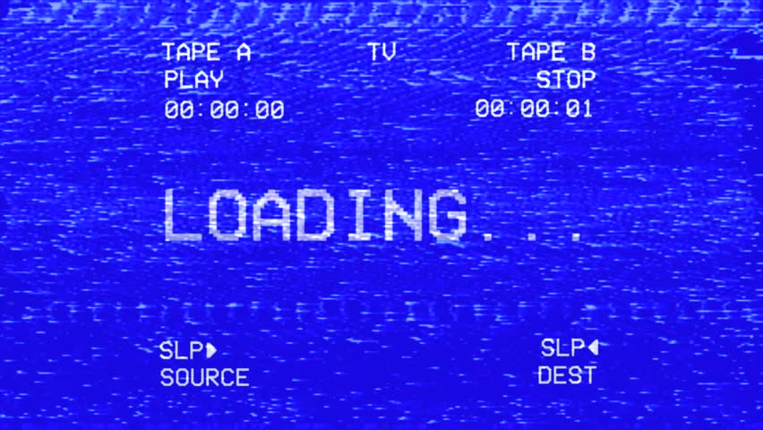 An old damaged VHS tape tracking a bad signal coming from a double deck, with the text Loading.  | Shutterstock HD Video #1009229873