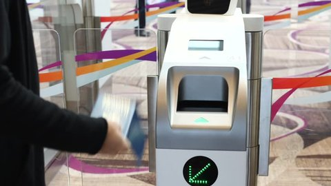 Immigration Automated Clearance System. Woman Scan Passport At Self-Check-In Customs.