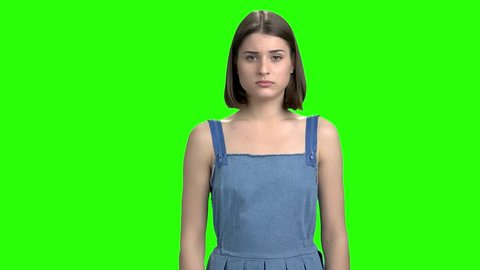 Portrait of woman is crying. Green screen hromakey background for keying.