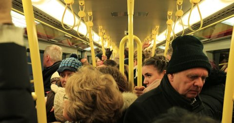 VIENNA, AUSTRIA - JANUARY 2018 - Commuters riding crowded metro subway station wagon in european town of Vienna during rush hour in 4K