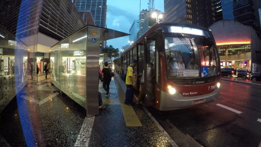 Sao Paulo, Brazil, March 27, 2018. Passengers board a bus, in Paulista Avenue, downtown Sao Paulo