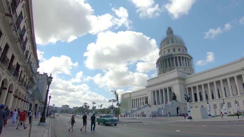 Havana Cuba capital building with old cars and the city center.