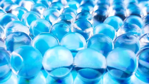 Water blue gel balls. Crystal liquid ball with reflection. Close up macro.