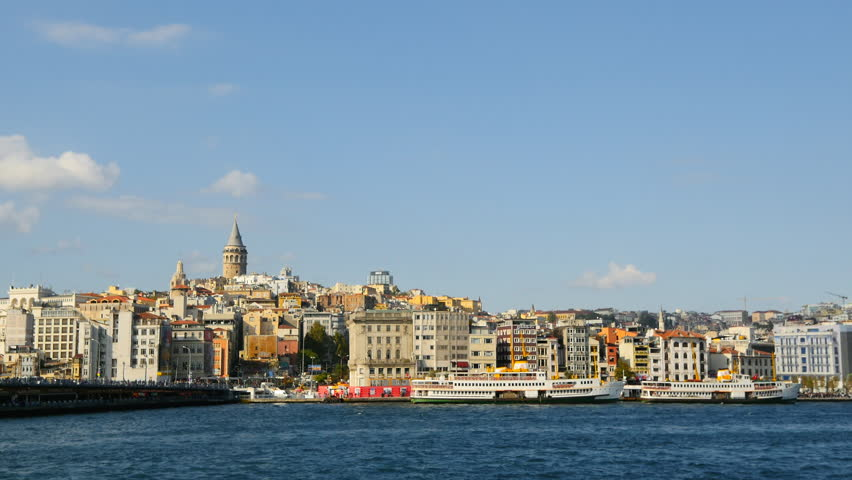Panning Slow Motion of Istanbul in Summer with the Galata Tower. City Sea Lines provide a welcome break from the bustle. Gyro stabilized panoramic shot from the water side