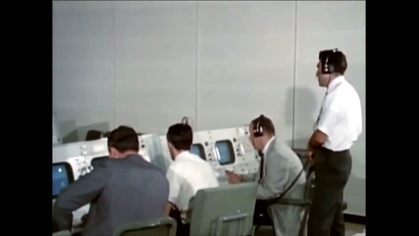 CIRCA 1966 - Work is shown in NASA's auxiliary control room during a space flight. | Shutterstock HD Video #1009379723