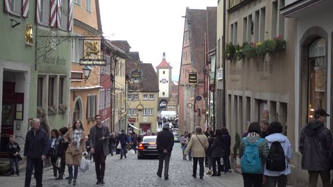 Rothenburg ob der Tauber, Germany - March 31, 2018: Street view of Rothenburg ob der Tauber, a well-preserved medieval old town in Middle Franconia in Bavaria on popular Romantic Road through southern
