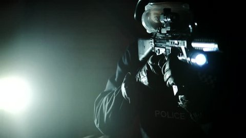 Cinematic Armed SWAT Police Officer Aims Rifle Guns In Tense Crime Action At Night, 4K.