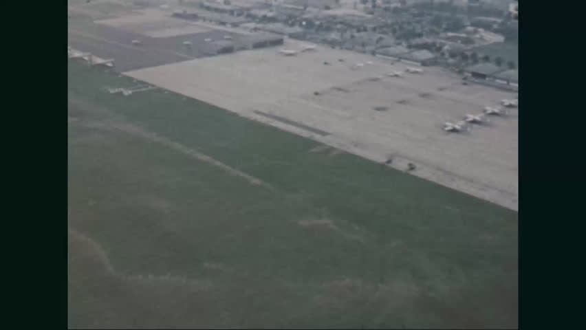 CIRCA 1967 - Aerial views of an USAF airfield outside of Detroit during the Detroit Riots.