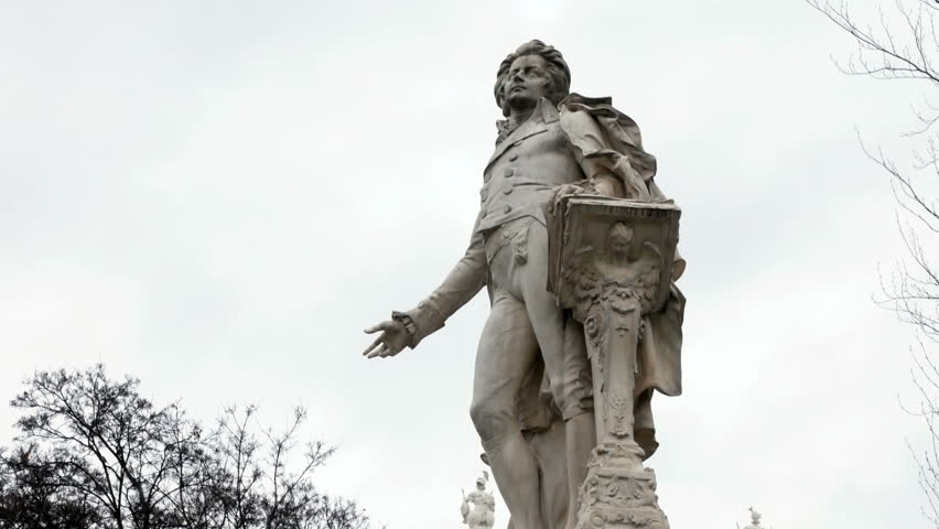 Mozart Statue in Vienna, Austria. Wolfgang Amadeus Mozart is definitely one of the best known names connected with Vienna and Austria. Mozarts statue in Vienna city center. Imperial Palace Gardens