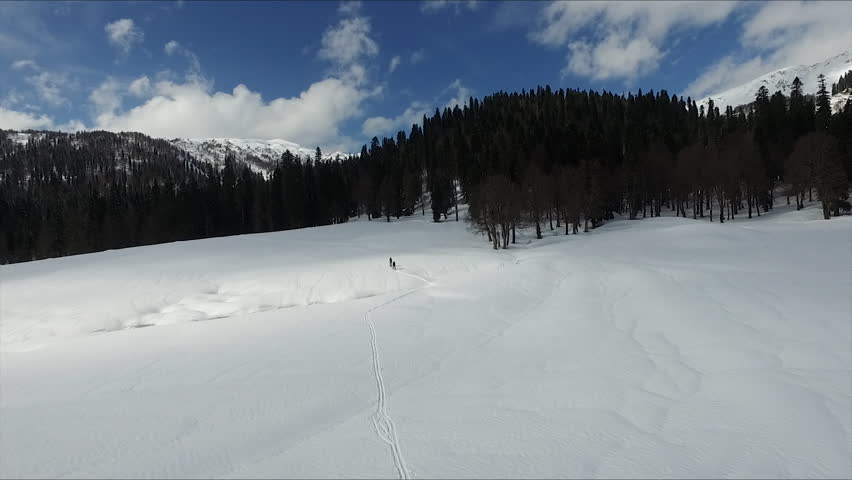 Aerial Flying over the Skiers Walking