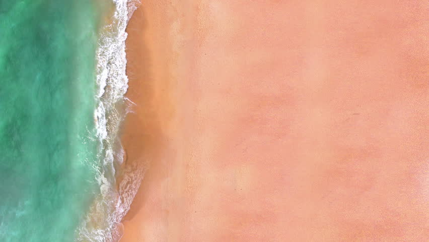 Aerial view of sand beach. Looping ocean texture, Top view sea waves slow motion, flying over tropical sandy beach and waves, Sunset  beach seamles loop.  #1009481003