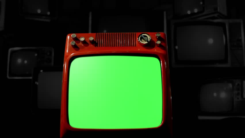 "Antique TV with Green Screen over a Black Bakground of Old TVs. BW Tone. Dolly Out Shot. You can replace green screen with the footage or picture you want. You can do it with ""Keying"" FX. 