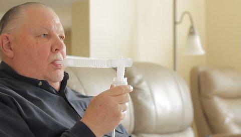 Man using a nebulizer