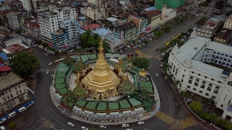 Drone shot time lapse, camera directly on top of pagoda in the centre of Yangon, Myanmar. Traffic time lapse in Yangon Myanmar. Sule Pagoda aerial shot