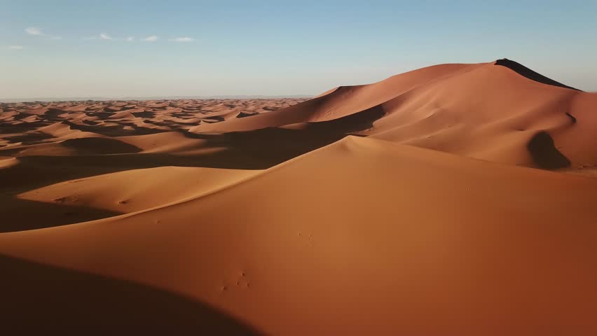 Aerial view on big sand dunes in Sahara desert at sunrise, Africa, 4k