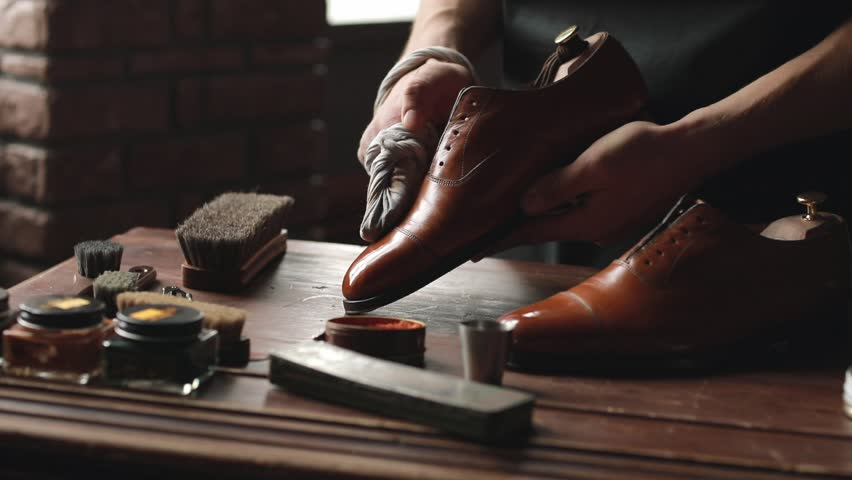 Shoe shop. Shoes master polishes boots | Shutterstock HD Video #1009533713