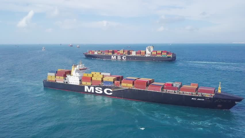 Mediterranean Sea - April 3, 2018: Aerial footage of an two MSC (Mediterranean Shipping Company) container ships at sea.