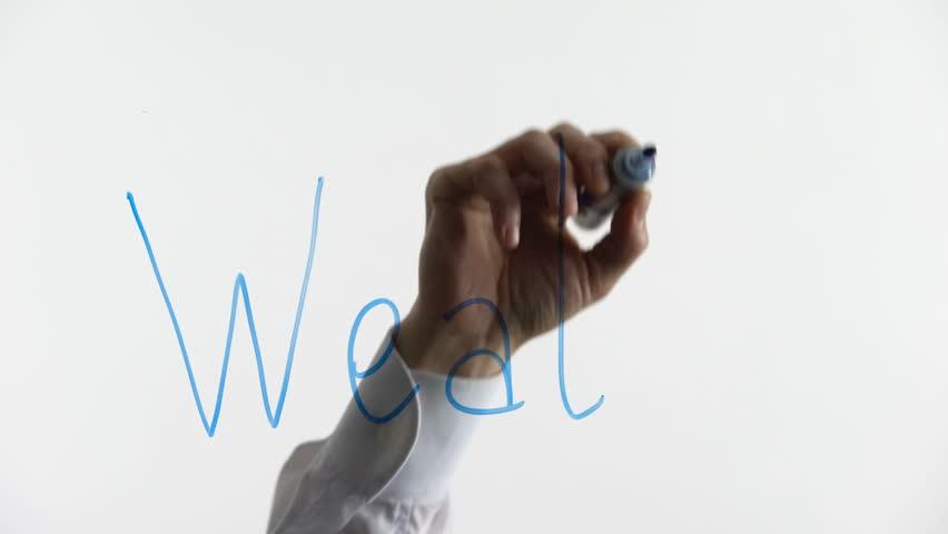 Wealth word written on glass, abundance of assets, unlimited opportunities