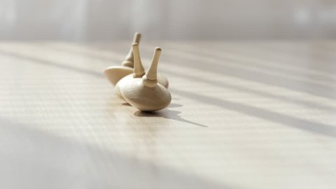 Wooden spinning top on a table. Closeup