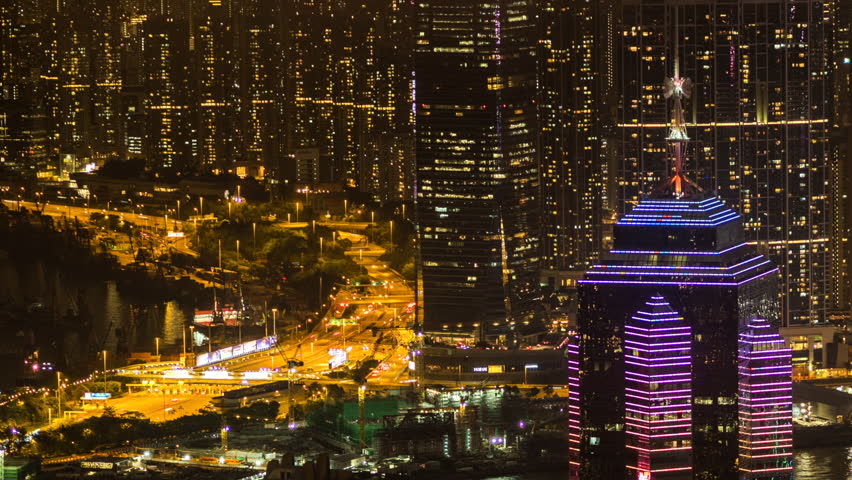 Hong Kong, China, time lapse view of skyscrapers at nighttime in one of Asia's most important business and financial hubs. Dolly right to left.
