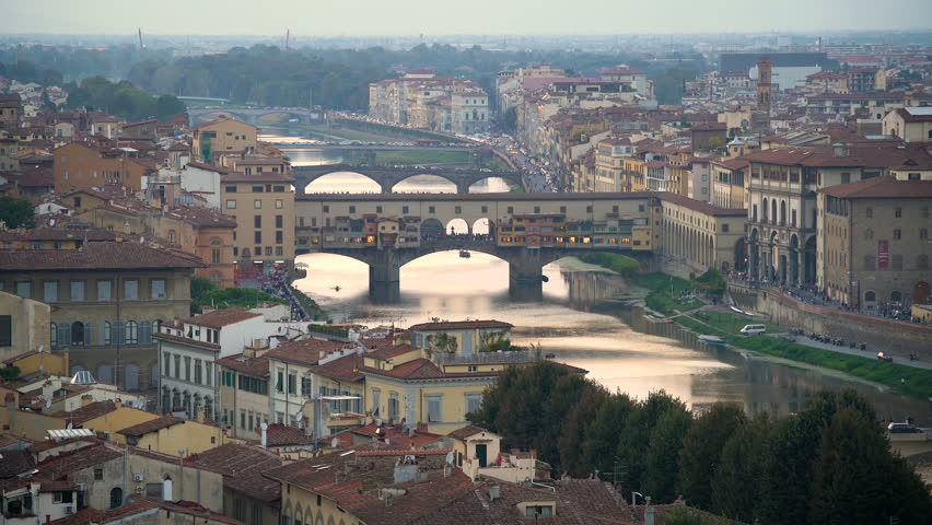 Florence Ponte Vecchio Bridge and City Skyline in Italy. Florence is capital city of the Italian region Tuscany. Florence was center of Italy medieval trade and wealthiest cities of era. | Shutterstock HD Video #1009688333
