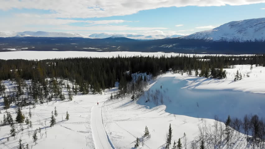 Aerial view of a woman cross country skiing in the swedish mountains