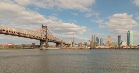 Time-lapse of to the Ed Koch, 59 Street Queensboro Bridge, the East River in Manhattan and the Queens, New York City skyline in the late afternoon.