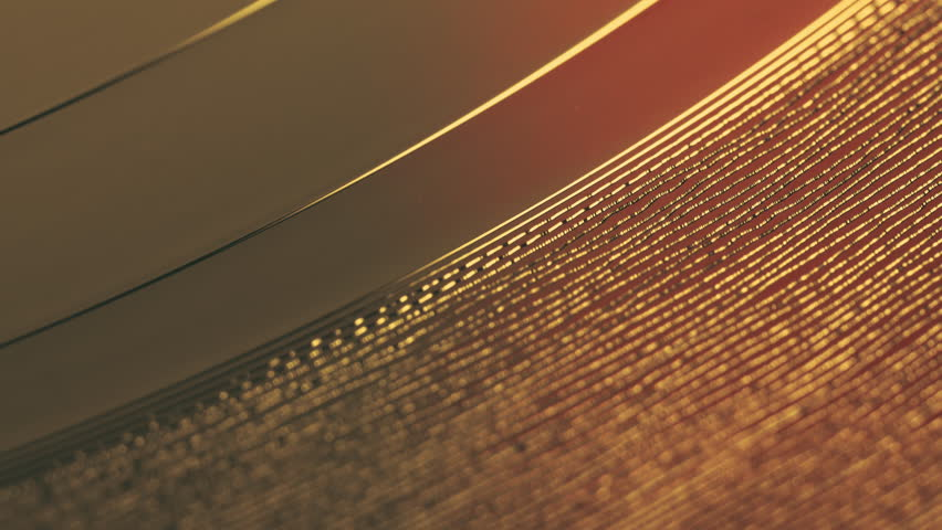 Fragment of a rotating golden vinyl record player. Macro. View from above. The moment of a spinning vinyl plate. Turntable vinyl record player. Audio equipment for disc jockey.